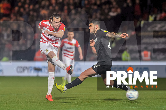 Doncaster Rovers forward John Marquis (9) shoots at the keeper during the Sky Bet League 1 match between Doncaster Rovers and Barnsley at the Keepmoat Stadium, Doncaster, England on 15 March 2019. Photo by Stephen Buckley / PRiME Media Images.
