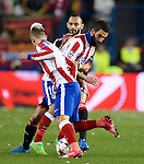 Leverkusen's Turkish defender Omer Toprak (C) vies with Atletico Madrid's Turkish midfielder Arda Turan during the round of 16 second leg UEFA Champions League football match Atletico de Madrid vs Bayern Leverkusen at the Vicente Calderon stadium in Madrid on March 17, 2015.  PHOTOCALL3000/ DP