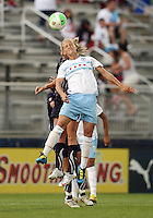 Allie Long #9 of the Washington Freedom is beaten to a header by Katie Chapman #17 of the Chicago Red Stars during a WPS match at the Maryland Soccerplex, in Boyds Maryland on June 12 2010. The game ended in a 2-2 tie.