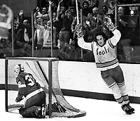 Seals goal by California Seals  Jim Moxey, Detroit Redwings goalie is #30 Bill McKenzie or Terry Richardson.(1975 photo/Ron Riesterer)