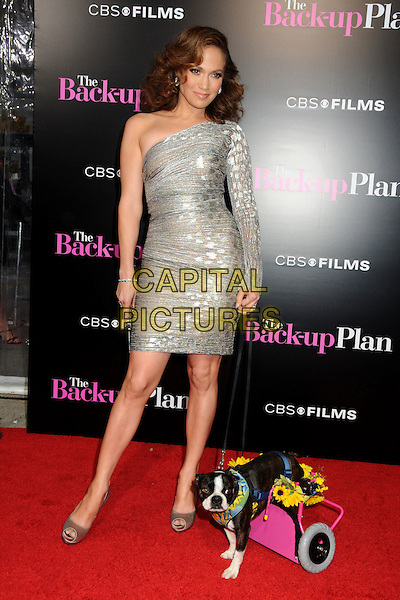 """JENNIFER LOPEZ .""""The Back-up Plan"""" Los Angeles Premiere held at the Regency Village Theatre, Westwood, California, USA, 21st April 2010..arrivals full length one shoulder silver dress sleeve shiny shimmery clutch bag shoes dog animal peep toe trolley flowers lead leash .CAP/ADM/BP.©Byron Purvis/AdMedia/Capital Pictures."""