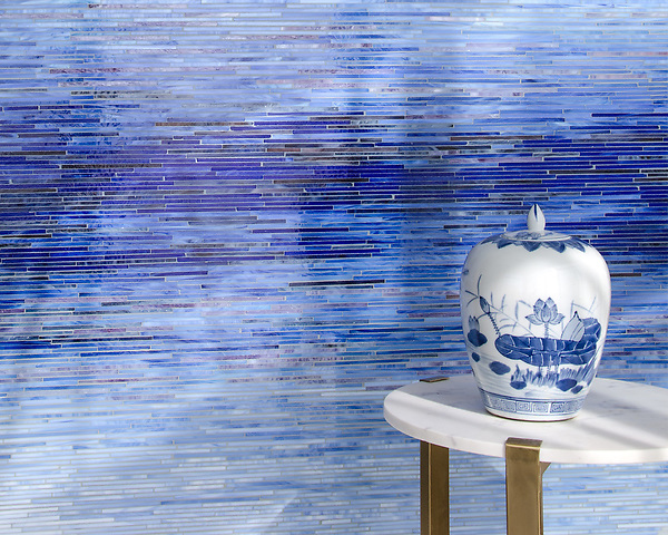 Ombre Tatami, a hand-cut jewel glass mosaic shown in Opal, Covellite, Delft, Iolite, Rhodolite, Sodalite, Lapis Lazuli, Ametrine, and Fluorite, inspired by an ombre watercolor, is part of the Broad Street™ collection by New Ravenna.