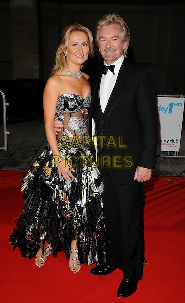 GUEST & NOEL EDMONDS .Attending the Variety Club Showbiz Awards 2008, held at Grosvenor House Hotel, London, England, .November 16th 2008..full length strapless black and silver grey gray dress gown suit bow tie tuxedo DJ ruffles sheer bodice .CAP/CAN.©Can Nguyen/Capital Pictures