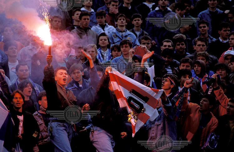 Croatian football fans burn a Red Star Belgrade (the top Serbian team) shirt following the vote in favour of independence for Croatia from the former Yugoslavia.