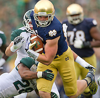 Tight end Troy Niklas (85) carries.
