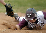 Windsor 22, Connor Johnson, gets back to the base on a very close play on a pick off at first as the ball is enters the glove of Manchester first basemen Myles Spencer, in the second inning during the game at Windsor High, Monday, April 29, 2013. (Jim Michaud / Journal Inquirer)