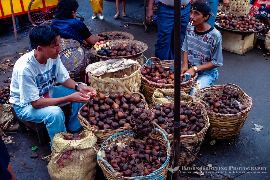 West Sumatra, Padang. Salak, or snake skin fruit, sold on the Padang market, Pasar Raya.