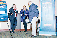 Former Virginia governor and Republican presidential candidate Jim Gilmore waits between interviews with NH campaign state director Anne Smith (center) and Gilmore's brother-in-law Lloyd Gatling, of Suffolk, Virginia, at the Radisson Hotel's Radio Row in Manchester, New Hampshire, on Mon., Feb. 8, 2016. Many television and radio stations set up in the hotel for their coverage of the primary in the final days of the campaign. Gilmore finished in last place among major Republican candidates still in the race with a total of 150 votes.
