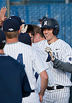 February 22, 2013: Nevada Wolf Pack first baseman Kewby Meyergets high fives after hitting a home run against the Northern Illinois Huskies during their NCAA baseball game played at Peccole Park on Friday afternoon in Reno, Nevada.