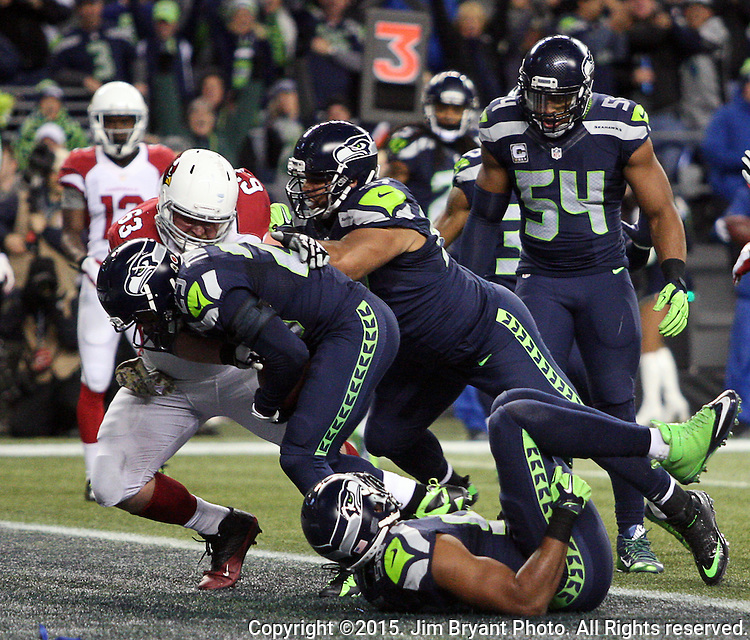 Seattle Seahawks free safety Earl Thomas (29) intercepts a pass intended for Arizona Cardinals wide receiver Michael Floyd(15) one the one yard line at CenturyLink Field in Seattle, Washington on November 15, 2015. The Cardinals beat the Seahawks 39-32.   ©2015. Jim Bryant photo. All Rights Reserved.