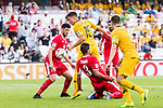 Chris Ikonomidis of Australia (C) is tackled by Jordan players during the AFC Asian Cup UAE 2019 Group B match between Australia (AUS) and Jordan (JOR) at Hazza Bin Zayed Stadium on 06 January 2019 in Al Ain, United Arab Emirates. Photo by Marcio Rodrigo Machado / Power Sport Images