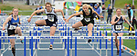 1608<br /> <br /> Eagle River&rsquo;s Morgan Bolin, center, leads Thunder Mountain&rsquo;s Audrey Welling, South&rsquo;s Olivia Maisey and Soldotna&rsquo;s Kylie Ness in a preliminary heat of the 100 high hurdles on Friday.  Photo for the Star by Michael Dinneen