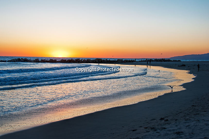 The sun sets on a winter day at Venice Beach, California.