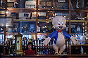 Porto, Portugal. 02.05.2015. The bar of the Galeria de Paris, where a model of Porky Pig presides over the eclectic and cluttered room. Photograph © Jane Hobson.