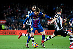 Lionel Andres Messi (C) of FC Barcelona fights for the ball with Sergio Postigo Redondo (R) and Cheik Doukoure of Levante UD  during the La Liga 2017-18 match between FC Barcelona and Levante UD at Camp Nou on 07 January 2018 in Barcelona, Spain. Photo by Vicens Gimenez / Power Sport Images