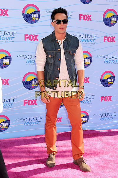 Michael Trevino.FOX's 2012 Teen Choice Awards held at The Gibson Ampitheatre in Universal City, California, USA..July 22nd, 2012.July 22nd, 2012.full length white top jean denim sleeveless orange jeans denim sunglasses shades.CAP/ADM/BP.©Byron Purvis/AdMedia/Capital Pictures.