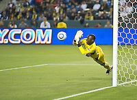 CARSON, CA – May 7, 2011: New York Red Bulls goalie Bouna Coundoul (18) dives to block a goal shot during the match between LA Galaxy and New York Red Bull at the Home Depot Center, May 7, 2011 in Carson, California. Final score LA Galaxy 1, New York Red Bull 1.
