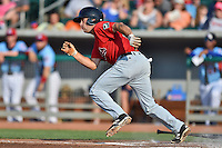 Birmingham Barons second baseman Dan Wagner #5 runs to first during a game against the Tennessee Smokies at Smokies Park on May 31, 2014 in , Tennessee. The Barons defeated the Smokies 2-1. (Tony Farlow/Four Seam Images)