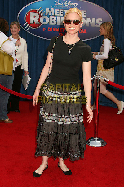 "BRIDGET FONDA.""Meet The Robinsons"" Los Angeles Premiere at the El Capitan Theatre, Hollywood, California, USA..March 25th, 2007.full length black skirt tee shirt top sunglasses shades .CAP/ADM/BP.©Byron Purvis/AdMedia/Capital Pictures"