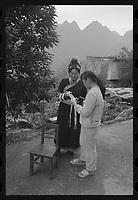 Bouyei women use mobile phone at Guanling Bouyei and Miao Autonomous County in Guizhou Province, 2018.