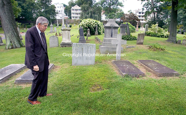 WATERBURY CT. 30 August 2013-083013SV04-John Ford, funeral director, from Naugatuck, checks out the spot where Fortune will be buried at Riverside Cemetery in Waterbury Friday. The medical examiner signed the death certificate 215 years after the man died in a tributary of the Naugatuck River. <br /> Steven Valenti Republican-American