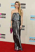 LOS ANGELES, CA - NOVEMBER 24: Emma Roberts arriving at the 2013 American Music Awards held at Nokia Theatre L.A. Live on November 24, 2013 in Los Angeles, California. (Photo by Celebrity Monitor)
