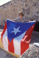 A U.S. National Park Ranger folds a Puerto Rican flag at El Moro in old San Juan, Puerto Rico. The fortress was built in the 1600's to protect the city.