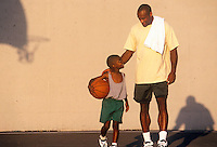 Father and son enjoy playing basketball.