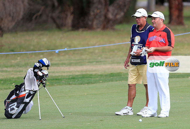 Damien McGrane (IRL) and caddy Pete on the 15th during Round 2 of the ISPS HANDA Perth International at the Lake Karrinyup Country Club on Friday 24rd October 2014.<br /> Picture:  Thos Caffrey / www.golffile.ie
