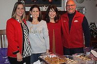 NWA Democrat-Gazette/CARIN SCHOPPMEYER Audre Darling, executive director of the Jackson L. Graves Foundation (from left), Angie Graves and Kelly and Scott Syer welcome guests to the annual Spread Good Cheer holiday treat event at the Syers' home.