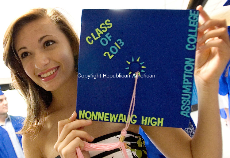 WOODBURY CT. 22 June 2013-062213SV06-Catherine LeClerc, 17, of Watertown shows off the college she will attend during her graduation ceremony at Nonnewaug High School in Woodbury Saturday.<br /> Steven Valenti Republican-American