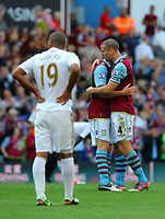 Saturday 15 September 2012<br /> Pictured: Aston Villa players celebrating their win after the final whistle while Luke Moore of Swansea (L) stands dejected.<br /> Re: Barclay's Premier League, Aston Villa v Swansea City FC at Villa Park, West Midlands, UK.