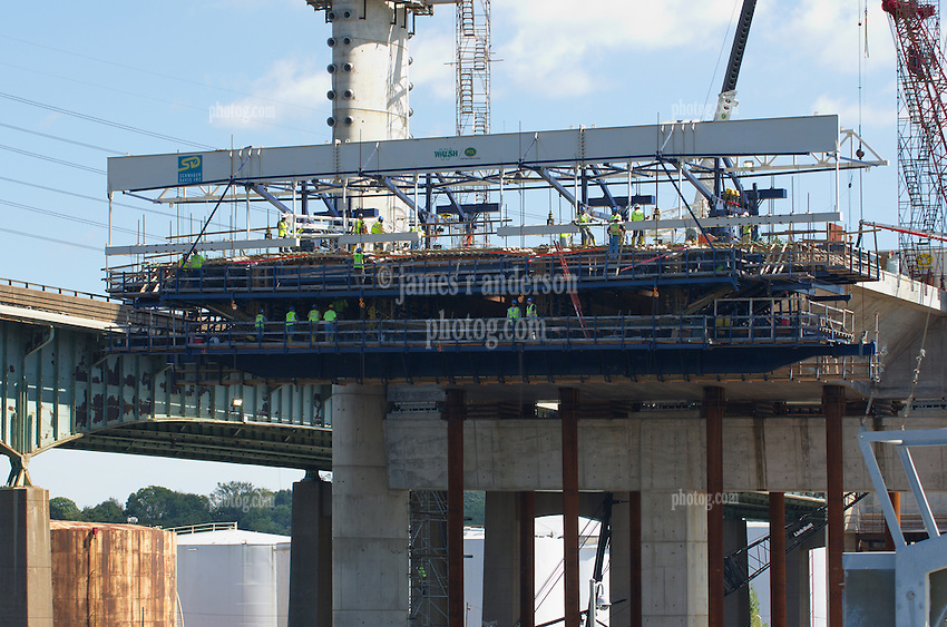 Pearl Harbor Memorial Bridge, New Haven Harbor Crossing Corridor, Interstate 95 in CT. Construction of Connecticut Department of Transportation Contract B as seen on September 9, 2011. New Northbound Span, Progress of the Replacement Bridge. When complete this will be the first Extradosed Bridge in the United States. This view includes Traveling Formwork. View East, deckwork leaving eastern pier.