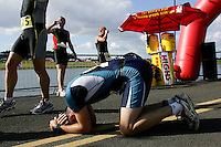 06 AUG 2005 - HOLME PIERREPONT, GBR - A competitor recovers after finishing the run at the British Club Relay Triathlon Championships (PHOTO (C) NIGEL FARROW)