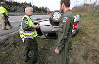 Anesthesiologist Hallstein S&oslash;reb&oslash; discuss with rescue paramedic Lars Markengbakken at an accident scene.  Crew from Norwegian Air Force 330 squadron, flying Westland Sea King helicopter. The core mission of the squadron is SAR (search and rescue), but they also fly HEMS (Helicopter Emergency Medical Service), complementing the civilian air ambulance service, and use a car in their local area. <br />