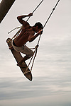 A surfer works out on the  surf swing on Praia do Rosa beach near Vida Sol e Mar Eco Resort, Santa Catarina, Brazil
