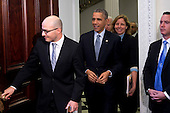 """United States President Barack Obama, center, arrives to meet with middle-school students who are participating in an """"Hour of Code"""" event in the Eisenhower Executive Office Building next to the White House in Washington, D.C., U.S., on Monday, December 8, 2014. The event is in honor of Computer Science Education Week. <br /> Credit: Andrew Harrer / Pool via CNP"""