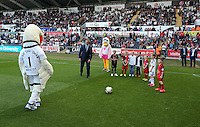 Pictured: Cyril and Cybil the swans with Club ambassador Lee Trundle and children mascots. Saturday 23 August 2014<br />