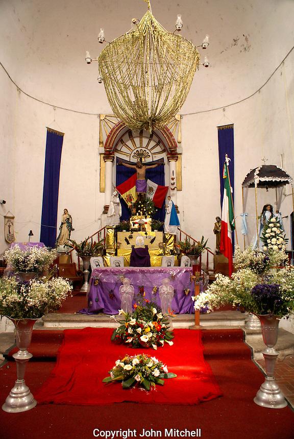 Main altar of La Iglesia de Cristo de Buen Viaje on the main square of  La Anitgua, Veracruz, Mexico. The village of La Antigua dates back to 1525. Hernan Cortes reportedly scuttled his ships here before marching inland to conquer the Aztecs.