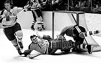 Seals Dick Redmond with goalie Gilles Meloche against the Pittsburg Penguins..(1971 photo/Ron Riesterer)