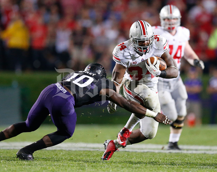 Ohio State Buckeyes running back Carlos Hyde (34) evades Northwestern Wildcats safety Traveon Henry (10) during Saturday's NCAA Division I football game at Ryan Field in Evanston on October 5 2013. (Barbara J. Perenic/The Columbus Dispatch)