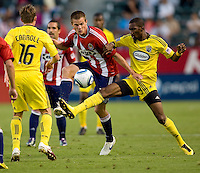 Chivas USA forward Justin Braun (17) battles Columbus Crew defender Shaun Francis (29) for the ball. CD Chivas USA defeated the Columbus Crew 3-1 at Home Depot Center stadium in Carson, California on Saturday July 31, 2010.
