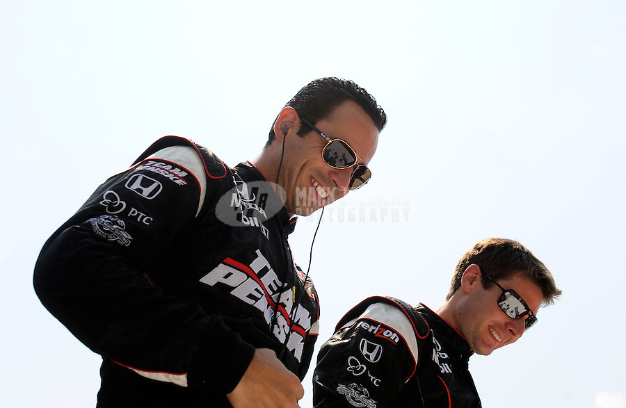 May 30, 2010; Indianapolis, IN, USA; IndyCar Series driver Helio Castroneves (left) and teammate Will Power during the Indianapolis 500 at the Indianapolis Motor Speedway. Mandatory Credit: Mark J. Rebilas-