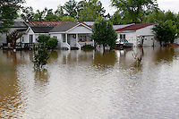 Homes near Sportsmen Park sit in flooded water in Poplar Bluff, MO on Wednesday, April 27, 2011. By Wednesday night, official water levels in Poplar Bluff had reached to 19.54 feet.