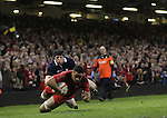 Wales number 8 Taulupe Faletau dives over to score in the corner despite the efforts of Alasdair Dickinson to stop him.<br /> RBS 6 Nations 2014<br /> Wales v Scotland<br /> Millennium Stadium<br /> <br /> 15.03.14<br /> <br /> &copy;Steve Pope-SPORTINGWALES