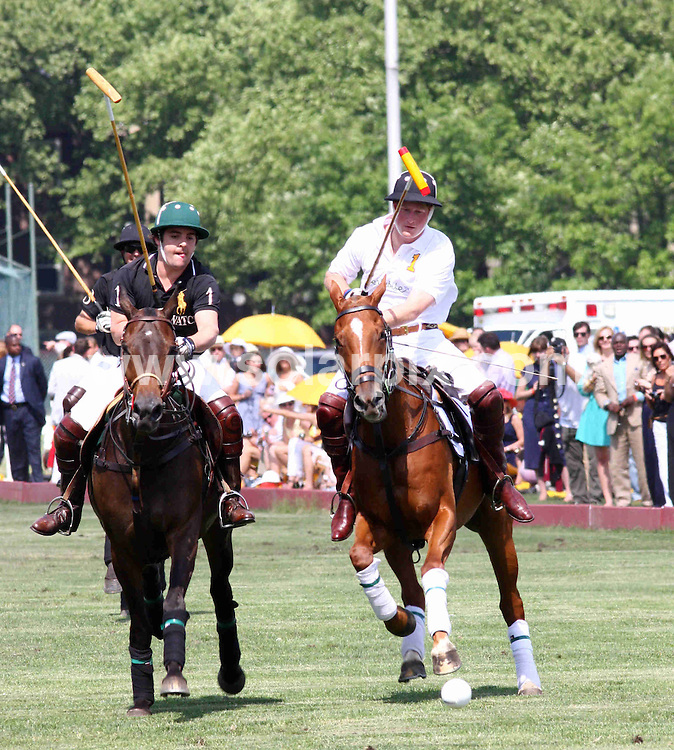 **ALL ROUND PICTURES FROM SOLARPIX.COM**.**SYNDICATION RIGHTS FOR UK, AUSTRALIA, DENMARK, PORTUGAL, S. AFRICA, SPAIN & DUBAI (U.A.E) ONLY**.Prince Harry Competes in the 2009 Veuve Clicquot Manhattan Polo Classic at Governors Island in New York USA..JOB REF: 9113    PHZ/Mayer    DATE: 30.05.09.**MUST CREDIT SOLARPIX.COM OR DOUBLE FEE WILL BE CHARGED**.**ONLINE USAGE FEE GBP 50.00 PER PICTURE - NOTIFICATION OF USAGE TO PHOTO @ SOLARPIX.COM**.**CALL SOLARPIX : +34 952 811 768 or LOW RATE FROM UK 0844 617 7637**