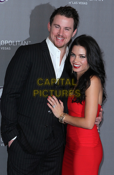 CHANNING TATUM & JENNA DEWAN .New Year's Eve Grand Opening of the Cosmopolitan of Las Vegas, Las Vegas, Nevada, USA, 31st December 2010..half length strapless black suit white shirt red dress arm around hand ring .CAP/ADM/MJT.© MJT/AdMedia/Capital Pictures.