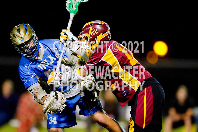 Los Angeles, CA 04/21/10 - Matt Creem (UCLA #34) and Erik Trelenberg (USC #12) in action during the cross town rivalry game between USC and UCLA, UCLA defeated USC 10-9 and secured a quarterfinal position in the MCLA-SLC playoff bracket.
