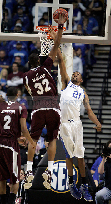 Senior forward Perry Stevenson tries to block a shot in the first half of UK's win 75-74 over Mississippi State  Bridgestone Arena in the SEC Finals on Sunday, March 14, 2010. Photo by Britney McIntosh | Staff