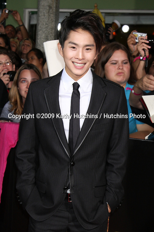 Justin Chon.arriving at the New Moon Premiere.Mann's Westwood Village Theater.Westwood,  CA.November 16, 2009.©2009 Kathy Hutchins / Hutchins Photo.